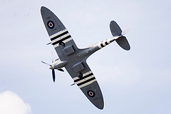 Yorkshire Wartime Experience Air Display by Mk IX Spitfire in Normandy Colours and the personal aircraft of Squadron Leader 'Johnny' Plagis, the Commanding Officer of No 126 Squadron from July 1944. Plagis named all of his personal Spitfires after his sister 'Kay' <br /> 04 July 2015<br />  Image © Paul David Drabble <br />  www.pauldaviddrabble.co.uk