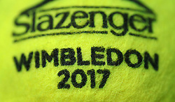 A Slazenger tennis ball on day four of the Wimbledon Championships at the All England Lawn Tennis and Croquet Club, Wimbledon. PRESS ASSOCIATION Photo. Picture date: Thursday July 6, 2017. See PA story TENNIS Wimbledon. Photo credit should read: Philip Toscano/PA Wire. RESTRICTIONS: Editorial use only. No commercial use without prior written consent of the AELTC. Still image use only - no moving images to emulate broadcast. No superimposing or removal of sponsor/ad logos.