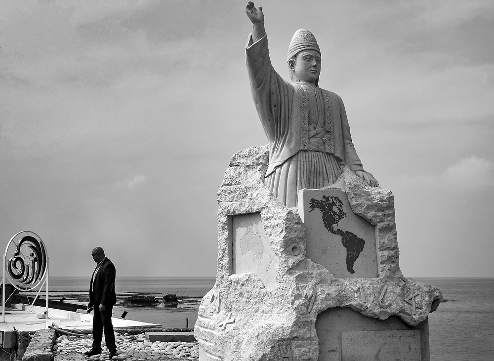 A security agent stands next to a statue in Byblos, Lebanon.