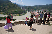 Orthodox Georgians visiting the 6th century Jvari Monastery in eastern Georgia. The Monastery stands on a rocky mountaintop at the confluence of the Mtkvari and Aragvi rivers, overlooking the town of Mtskheta, which was formerly the capital of the Kingdom of Iberia...10 June 2012