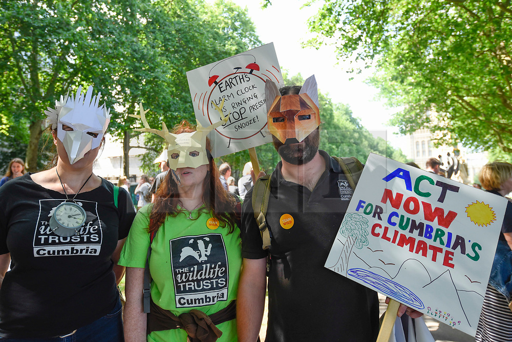 """© Licensed to London News Pictures. 26/06/2019. LONDON, UK.  People take part in a """"Time Is Now"""" mass lobby around Parliament.  Activists are attempting to deliver a message to MPs that to tackle the environmental crisis, a strong Environment Bill is passed that can restore nature, cut plastic pollution and improve air quality.  Similar gatherings are taking place across the UK.   Photo credit: Stephen Chung/LNP"""