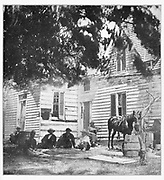 A HOUSE NEAR WASHINGTON STRUCK BY ONE OF EARLY S SHELLS from the book ' The Civil war through the camera ' hundreds of vivid photographs actually taken in Civil war times, sixteen reproductions in color of famous war paintings. The new text history by Henry W. Elson. A. complete illustrated history of the Civil war