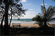 Bench seat on a beach looking out to sea, Thailand Asia