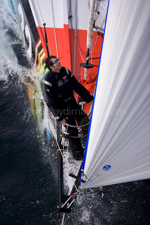 """Pictures of solo yachtsman Brain Thompson at the helm of his Open 60 """"Kingdom of Bahrain - Pindar"""" shown here training offshore in Lorient. France. Prior to his departure in the Vendee Globe 2008. The  non stop solo yacht race satrting in early in November...All pictures must be credited """"Lloyd Images"""""""