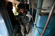 Badal, 8, runs through the train at full speed grabbing any bottles he sees as quickly as possible before one of the other kids grabs it first.  Children, some who have run away from their families, find themselves living homeless on the train tracks waititng for the next train to arrive at the train station in Jaipur, India.  Once the train arrives they raid the train looking for plastic bottles that they can then sell.  Most will make about $1.50/day but spend most of it on glue which they are most addicted to.