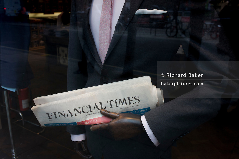 The Financial Times in the arm of a central London menswear shop mannequin
