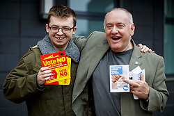 © Licensed to London News Pictures. 18/09/2014. Glasgow, UK. Campaigners posing outside polling stations in Glasgow whilst people of Scotland vote on the Scottish independence referendum on Thursday, 18 September 2014. Photo credit : Tolga Akmen/LNP