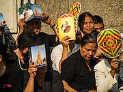 16 DECEMBER 2015 - BANGKOK, THAILAND: People line Krung Kasem Street in Bangkok during the funeral of Somdet Phra Nyanasamvara, Thailand's Supreme Patriarch. He died Oct. 24, 2013. He was ordained as a Buddhist monk in 1933 and appointed as the Supreme Patriarch in 1989. He was the spiritual advisor to Bhumibol Adulyadej, the King of Thailand when the King served as a monk in 1956. Tens of thousands of people lined the streets during the procession to pray for the Patriarch.     PHOTO BY JACK KURTZ