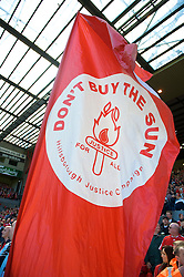 """LIVERPOOL, ENGLAND - Saturday, April 11, 2009: A flag on the Spion Kop reading: """"Don't buy the Sun"""". The newspaper is villified and boycotted in Liverpool after it ran sick lies under the headline 'The Truth' about the Hillsborough Stadium Disaster in which 96 football fans lost their lives on April 15, 1989. (Photo by: David Rawcliffe/Propaganda)"""