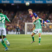 BARCELONA, SPAIN - August 25:  Frenkie de Jong #21 of Barcelona climbs high over Sergio Canales #10 of Real Betis to win the ball during the Barcelona V  Real Betis, La Liga regular season match at  Estadio Camp Nou on August 25th 2019 in Barcelona, Spain. (Photo by Tim Clayton/Corbis via Getty Images)