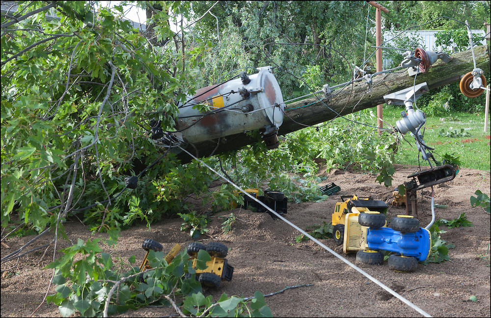 Powerlines, transformers, children's toys, house debris are among the things that were thrown around during the Watkins, Minnesota EF-2 tornado.