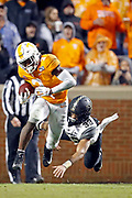 Tennessee running back Eric Gray (3) escapes from Vanderbilt safety Dashaun Jerkins (33) en route to a 94-yard touchdown in the first half of an NCAA college football game Saturday, Nov. 30, 2019, in Knoxville, Tenn. (AP Photo/Wade Payne)