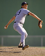 SARASOTA, FL - 1987:  Dave Righetti of the New York Yankees pitches during a major league baseball spring training game at Payne Park in Sarasota, Florida prior to the 1987 season.  (Photo by Ron Vesely) Subject:   Dave Righetti