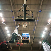 122914  Adron Gardner/Independent<br /> <br /> Tuba City Warrior Tristin Begay (15) floats under the lights for a warmup goal before the warriors battled the Winslow Bulldogs during the Tournament of Champions boys final at the Stronghold Event Center in Fort Defiance Monday.