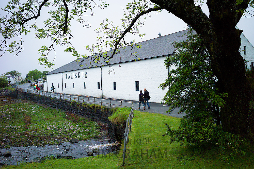 Tourists arriving for visitors tour at the Talisker Single Malt Whisky Distillery in Carbost on Isle of Skye, in the Highlands of Scotland