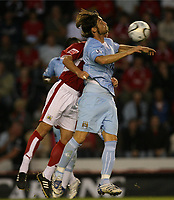 Photo: Rich Eaton.<br /> <br /> Bristol City v Manchester City. Carling Cup. 29/08/2007. Man City's Rolando Bianchi (r) chests the ball.