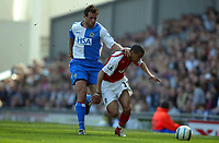 Fotball<br /> Premier League 2004/05<br /> Blackburn v Arsenal<br /> 19. mars 2005<br /> Foto: Digitalsport<br /> NORWAY ONLY<br /> Lucas Neill of Blackburn Rovers tangles with Gael Clichy of Arsenal