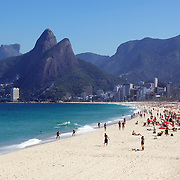 A beach scene looking along the stretch of beaches including Arpoador, Ipanema and Leblon beaches and showing the twin peaks of dois irmaos. Rio de Janeiro, Brazil. 6th July 2010. Photo Tim Clayton..