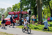 The Mr Whippy ice cream van makes a popular return. Clapham Common is not that busy despite the sun being out and that now people are allowed to sit, if only briefly, on the benches. The 'lockdown' continues for the Coronavirus (Covid 19) outbreak in London.