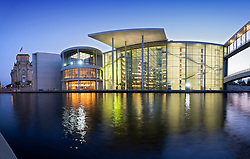 Government buildings at dusk beside Spree River in central Berlin Germany