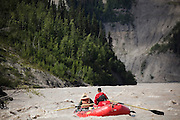 St. Elias Alpine Guides tour guide Jake Wilkens and clients Brandie Radigan Dicks and J.R. Dicks float down the Nizina River on a guided day trip out of McCarthy, Alaska.