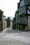 Antique shop and people at the top of Steep Hill, Lincoln, Lincolnshire, England  1963