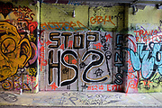 HS2 protest spray painted street art and graffiti at the popular Leake Street Arches on 5th March 2021 in London, England, United Kingdom. Leake Street is a road tunnel in Lambeth, where graffiti is tolerated and encouraged regardless of the fact that it is against the law. The street is about 300 metres long, runs off York Road and under the platforms and tracks of Waterloo station.