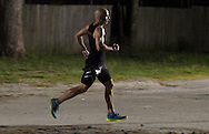 Augusta, New Jersey - A runner on the course at night during the 3 Days at the Fair long distance races at Sussex County Fairgrounds on May 12, 2012. Runners completed 6-, 12-, 24-, 48- and 72-hour races.