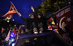Supporters of Turkey's President and ruling Justice and Development Party, or AKP, leader Recep Tayyip Erdogan celebrate outside the party headquarters in Istanbul, Sunday, June 24, 2018. Unofficial results from Turkey's presidential election show incumbent Recep Tayyip Erdogan with a commanding lead. Photo by Akin Celiktas/DHA/Depo Photos/ABACAPRESS.COM