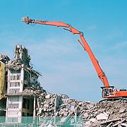 Crane breaking down a building