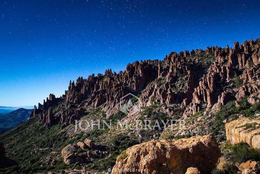 A view of one of the ridges on the Peralta Trail iluminated by a full moon.  Captured while descending back to the trailhead after a beautiful sunset near Weaver's Needle.