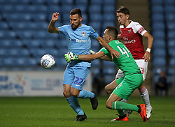 Coventry City's Tony Andreu (left) battles with Arsenal's Julio Pleguezuelo (right) and goalkeeper Dejan Iliev