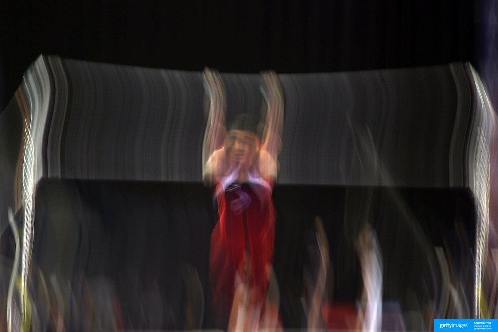 A blur of motion as a gymnast performs on the Horizontal bar during the Senior Men Competition at The 2013 P&G Gymnastics Championships, USA Gymnastics' National Championships at the XL, Centre, Hartford, Connecticut, USA. 16th August 2013. Photo Tim Clayton