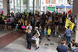 London, UK. 17 July, 2019. Climate activists from Extinction Rebellion assemble outside Hammersmith Town Hall at the end of a Critical Mass bicycle ride from Waterloo Millennium Green on the third day of their 'Summer uprising'. The activists have three demands for Hammersmith and Fulham Council: to pass the proposed motion to declare a Climate Emergency; to keep Hammersmith bridge closed to vehicles; and to commit to safer cycling routes.