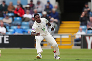 Fidel Edwards of Hampshire fields the ball off his own bowling during the opening day of the Specsavers County Champ Div 1 match between Yorkshire County Cricket Club and Hampshire County Cricket Club at Headingley Stadium, Headingley, United Kingdom on 27 May 2019.