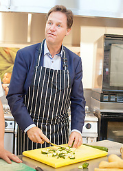 © Licensed to London News Pictures. 02/09/2014. London, UK. Nick Clegg chops vegetables in the school's kitchen. Deputy Prime Minister Nick Clegg launches free school meals at Clapham Manor Primary School in Lambeth today 2nd September 2014. For many school returning from the school holidays this is the first day of the Governments universal infant free school meals.  Photo credit : Stephen Simpson/LNP