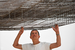 "© Licensed to London News Pictures. 16/09/2019. LONDON, UK.  Antony Gormley RA poses next to his work ""Matrix III"", 2019.  Preview of a new exhibition by Antony Gormley at the Royal Academy of Arts.  The show bring together existing and specially conceived new works from drawing to sculptures to experimental environments to be displayed in all 13 rooms of the RA's Main Galleries 21 September to 3 December 2019.  Photo credit: Stephen Chung/LNP"