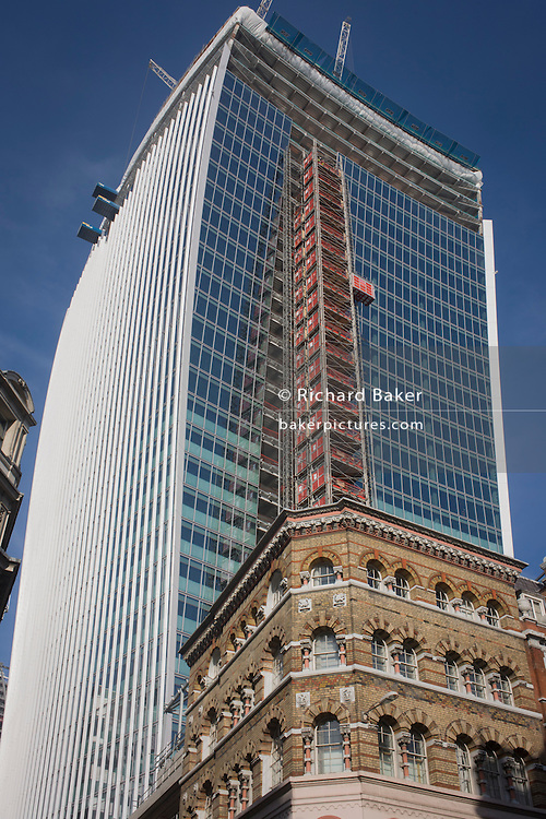 Growing above older Victorian architecture is a new tower block that rises above a Victorian office block in the City of London. The fast-rising project is 20 Fenchurch Street, a skyscraper under construction on Fenchurch Street in London. It has been nicknamed the Walkie-Talkie and the Pint because of its bulbous top.[1] Upon completion in summer 2014 the building will be 160 m (525 ft) tall, with 36 storeys. Costing over £200 million, it is designed by architect Rafael Viñoly.