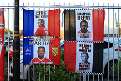 30-9-2015 ENG: UEFA Champions League Manchester United - VfL Wolfsburg, Manchester<br /> Souvenir flags bearing the faces of Eric Cantona, Anthony Martial, Memphis Depay and Wayne Rooney fixed to a fence<br />  Photo: Simon Stacpoole / Offside.<br /> <br /> ***** NETHERLANDS ONLY ******