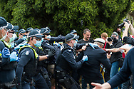 An elderly man is seen being arrested during the Melbourne Freedom Rally at The Shrine. Premier Daniel Andrews promises 'significant' easing of Stage 4 restrictions this weekend. This comes as only one new case of Coronavirus was unearthed over the past 24 hour and no deaths. (Photo by Dave Hewison/Speed Media)