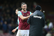 Andy Carroll of West Ham United laughing with a member of the back room staff after full time. The Emirates FA cup, 3rd round match, West Ham Utd v Wolverhampton Wanderers at the Boleyn Ground, Upton Park  in London on Saturday 9th January 2016.<br /> pic by John Patrick Fletcher, Andrew Orchard sports photography.