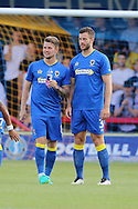 AFC Wimbledon midfielder Jake Reeves (8) & AFC Wimbledon defender Jon Meades (3) during the Pre-Season Friendly match between AFC Wimbledon and Crystal Palace at the Cherry Red Records Stadium, Kingston, England on 27 July 2016. Photo by Stuart Butcher.