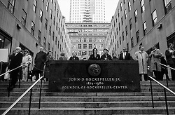 People standing and watching ice skaters in Rockefeller center in Manhattan, New York - Rockefeller center í New York