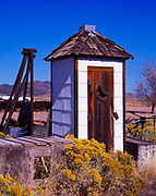 Sparkling white outhouse with cedar shake roof and cedar door, ghost town of Modena, Utah.