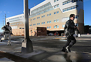 pvc010411b/1-4-11/asec.  An unidentified  Bernalillo County Sheriffs deputy, left, an an unidentified police officer, right, race along a sidewalk with weapons drawn as an active shooter situation unfolds at UNMH, photographed Tuesday Jan. 4, 2011.  (Pat Vasquez-Cunningham/Journal)