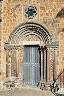 Romanesque side portal of the Basilica Church of Santa Maria Maggiore, Tuscania .<br /> <br /> Visit our ITALY PHOTO COLLECTION for more   photos of Italy to download or buy as prints https://funkystock.photoshelter.com/gallery-collection/2b-Pictures-Images-of-Italy-Photos-of-Italian-Historic-Landmark-Sites/C0000qxA2zGFjd_k .<br /> <br /> Visit our MEDIEVAL PHOTO COLLECTIONS for more   photos  to download or buy as prints https://funkystock.photoshelter.com/gallery-collection/Medieval-Middle-Ages-Historic-Places-Arcaeological-Sites-Pictures-Images-of/C0000B5ZA54_WD0s