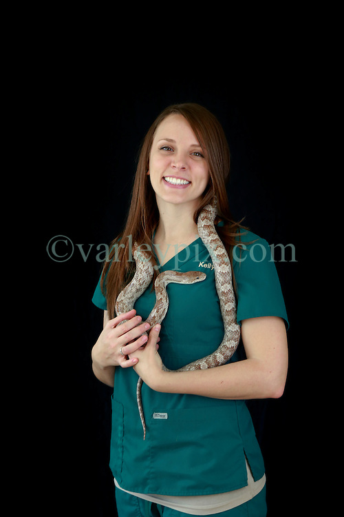 14 January 2014. New Orleans, Louisiana.<br /> Lakeview Veterinary Hospital Inc. <br /> Kelly Eastlund, technician. Pictured with Elmo the rat snake.<br /> Photo Credit; Charlie Varley