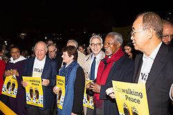 "London, October 23 2017. Nelson Mandela's group of Elders including former UN Secretary General Kofi Annan and Secretary General Ban Ki-moon accompanied by his widow Graca Machel gather at Parliament Square at the start of the Walk Together event in memory of Nelson Mandela before a candlelight vigil at his statue in Parliament Square. ""WalkTogether is a global campaign to inspire hope and compassion, celebrating communities working for the freedoms that unite us"". PICTURED: The Elders, retired leaders at the head of the march. © Paul Davey"