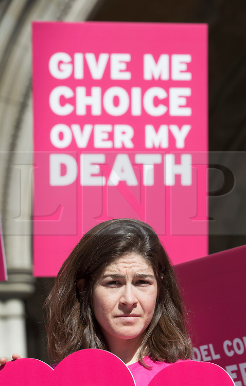 """© Licensed to London News Pictures. 01/05/2018. London, UK. A supporter of terminally ill man Noel Conway demonstrates outside The High Court as he challenges the law on assisted suicide. Mr Conway, who has motor neurone disease, is asking judges to acknowledge his """"basic right to die"""". Photo credit: Peter Macdiarmid/LNP"""