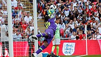 Football - 2018 International Friendly (pre-World Cup warm-up) - England vs. Nigeria<br /> <br /> Francis Uzoho (Nigeria) saves from a Kieran Trippier (England) free kick at Wembley Stadium.<br /> <br /> COLORSPORT/DANIEL BEARHAM